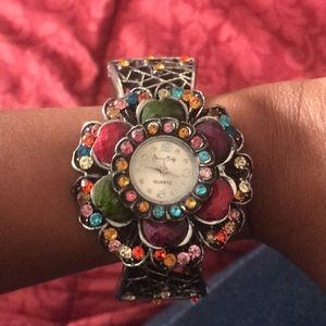 Silver bracelet watch with colored rhinestones
